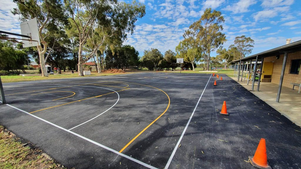 A sports court with fresh line markings painted
