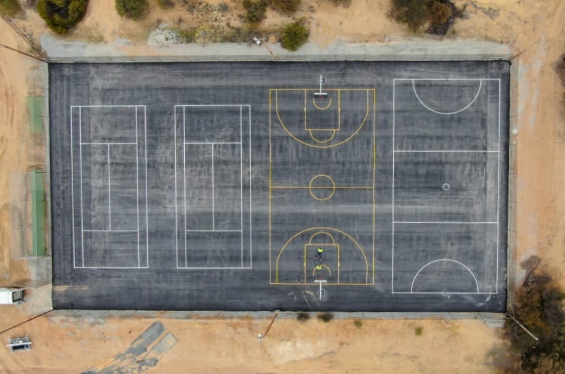 Lines painted for a sports court in Merredin